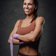 Smiling sportswoman poses in dark background with bandages - PhotoDune Item for Sale