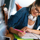 Pretty young college student studying, preparing for exam - PhotoDune Item for Sale