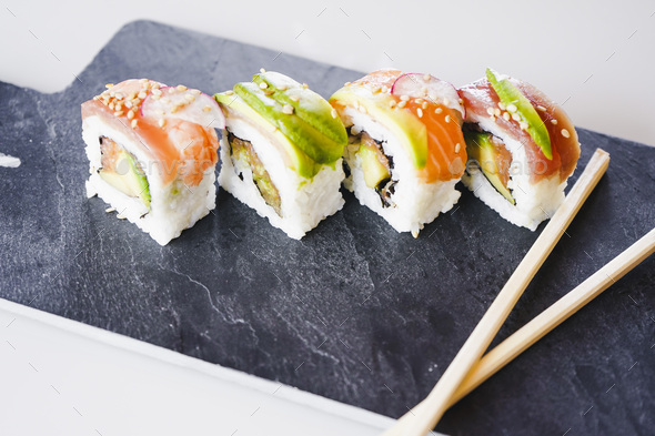 Delicious variety of sushi california rolls - Stock Photo - Images