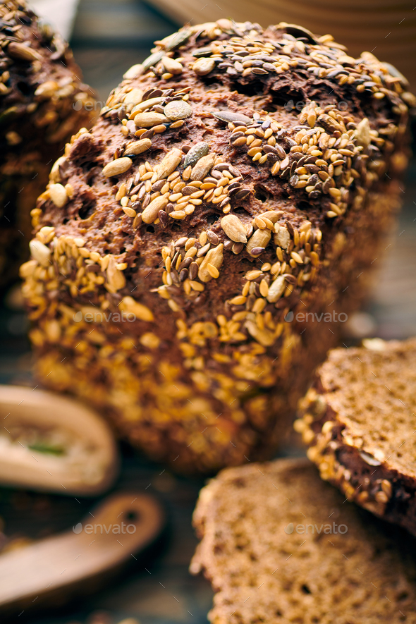 Homemade bread on dark wooden table - Stock Photo - Images