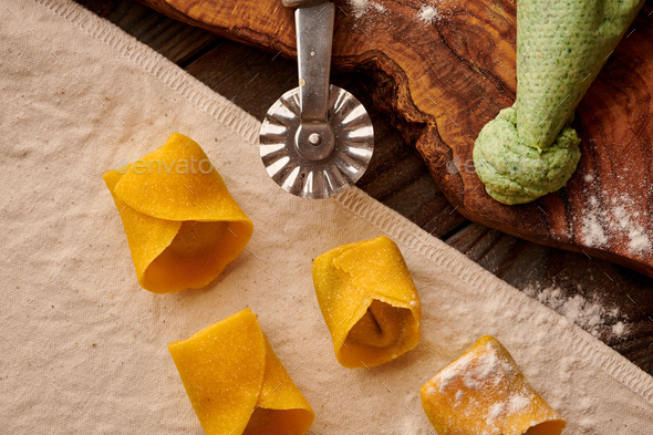 Raw homemade ravioli pasta with spinach and ricotta - Stock Photo - Images