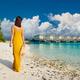 Woman in dress walking on tropical beach - PhotoDune Item for Sale