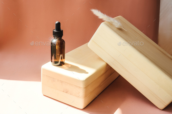 Blank amber glass essential oil bottle - Stock Photo - Images