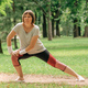 Female jogger stretching muscles and warming up for running exercise in park - PhotoDune Item for Sale