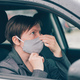 Woman wearing protective face mask in car during covid-19 pandemics - PhotoDune Item for Sale