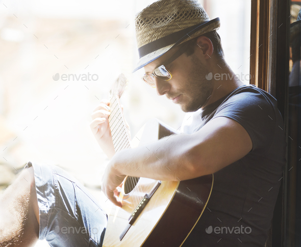 Man playing the guitar - Stock Photo - Images
