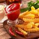 Tasty french fries on wooden table background - PhotoDune Item for Sale