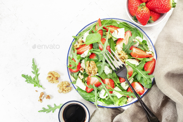 Strawberry Salad with spinach, arugula, walnuts, blue cheese - Stock Photo - Images