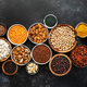 Selection of superfoods, legumes, cereals, nuts, seeds in bowls - PhotoDune Item for Sale