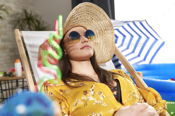 Close up of woman relaxing on the beach at home - Stock Photo - Images