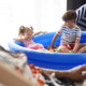 Children sitting in an inflatable ball pool at home - PhotoDune Item for Sale