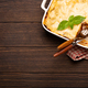 Traditional Italian lasagna in casserole pan on wooden table - PhotoDune Item for Sale
