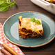 Traditional Italian lasagna on plate on wooden table - PhotoDune Item for Sale