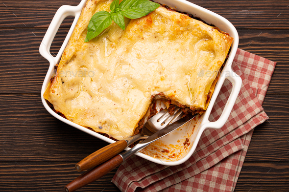 Traditional Italian lasagna on plate on wooden table - Stock Photo - Images