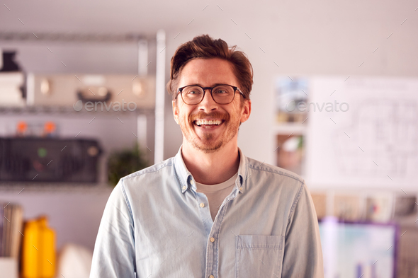Portrait Of Smiling Male Architect In Office Standing By Desk - Stock Photo - Images