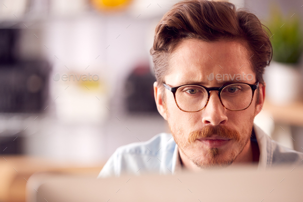 Close Up Of Male Architect In Office Working On Desktop Computer Viewed From Behind Screen - Stock Photo - Images