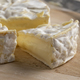 French ripe camembert cheese and and a piece close up - PhotoDune Item for Sale