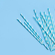 Striped and dotted paper drinking straws on light blue background - PhotoDune Item for Sale