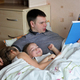 Happy children lying in bed with their father who is reading a book - PhotoDune Item for Sale