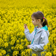 Girl in a yellow rapeseed field - PhotoDune Item for Sale
