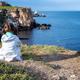 Girl at a rocky coastline - PhotoDune Item for Sale