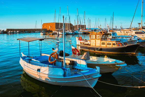 Venetian Fort in Heraklion and moored fishing boats, Crete Island, Greece - Stock Photo - Images