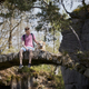 Man with his dog sitting old stone bridge in beautiful nature - PhotoDune Item for Sale