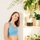 Portrait of happy smiling woman near plants. - PhotoDune Item for Sale