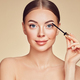 Beauty woman applying black mascara on eyelashes - PhotoDune Item for Sale
