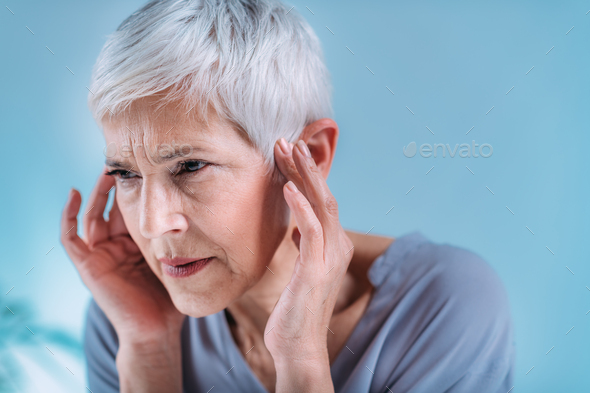 Senior Woman Suffering From Tinnitus - Stock Photo - Images
