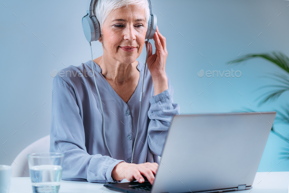 Senior Woman Doing Audiogram Hearing Test at Home, using Laptop - Stock Photo - Images