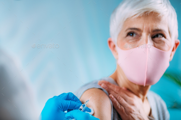 Hands of a nurse, holding a syringe with coronavirus vaccine. - Stock Photo - Images
