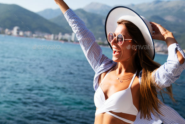 Sexy healthy woman meditating at serene tropical beach and enjoying summer vacation - Stock Photo - Images