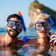 Group of happy fit friends go scuba diving together on summer vacation - PhotoDune Item for Sale