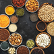 Selection of superfoods, legumes, cereals, nuts, seeds in bowls on black background - PhotoDune Item for Sale