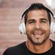 Hispanic man listening music with headphones - Focus on face - PhotoDune Item for Sale