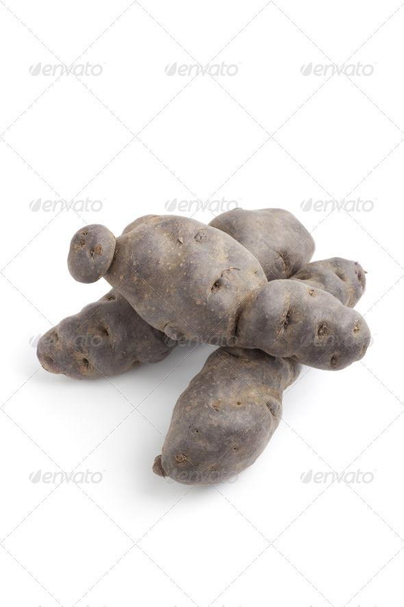 Whole Vitelotte noir potatoes - Stock Photo - Images