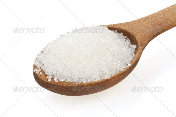 granulated sugar  in spoon on white - Stock Photo - Images