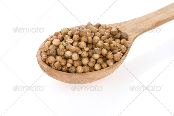 Coriander spices in spoon on white - Stock Photo - Images