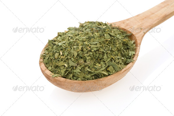 parsley spices in spoon on white - Stock Photo - Images
