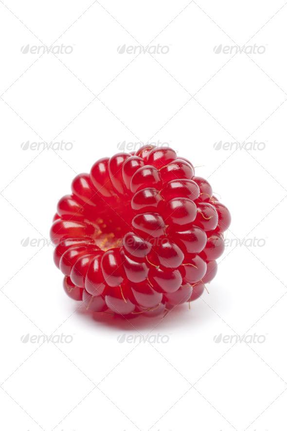 Whole single fresh red edible Japanese Wineberry - Stock Photo - Images