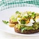 Sandwich with avocado puree, boiled eggs and sandwich cream cheese, kiwi, nuts. - PhotoDune Item for Sale