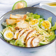 Caesar salad with lettuce, chicken, avocado and croutons on light table. - PhotoDune Item for Sale