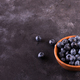 Blueberries in a bowl on a stone table - PhotoDune Item for Sale