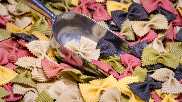 Colored Farfalle Pasta bow tie pasta background. - Stock Photo - Images