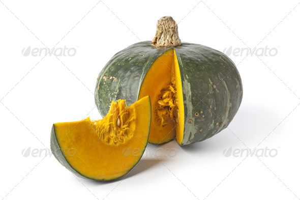 Green pumpkin with orange pulp - Stock Photo - Images