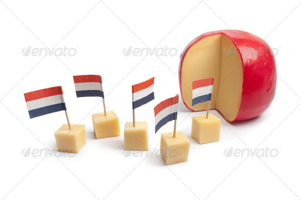 Dutch Edam cheese blocks with the Dutch flag - Stock Photo - Images