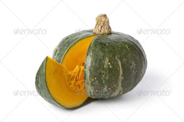 Green pumpkin with a slice - Stock Photo - Images