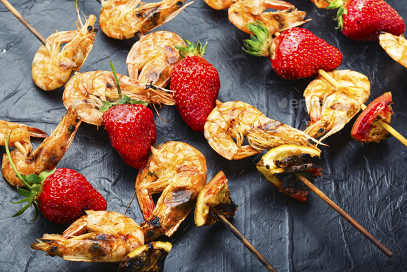 Grilled shrimps on skewers with strawberries,BBQ shrimp - Stock Photo - Images