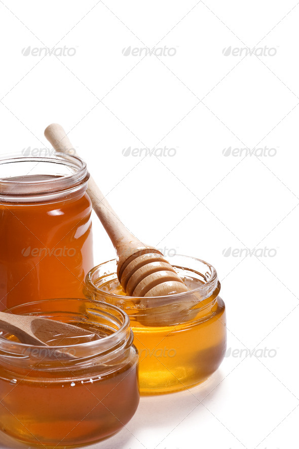 glass pots of honey - Stock Photo - Images